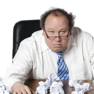 Angry HR Manager and Crumpled Up Paper Forms